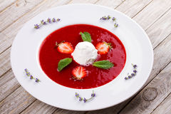 Strawberry soup with ice cream and mint Royalty Free Stock Photo