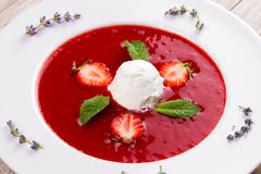 Strawberry soup with ice cream and mint Royalty Free Stock Photography