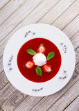 Strawberry soup with ice cream and mint Stock Images