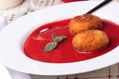 Strawberry soup with italian fried rice balls. Arancini and mint Royalty Free Stock Photos