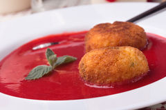 Strawberry soup with italian fried rice balls. Arancini and mint Stock Photography