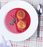 Strawberry soup with italian fried rice balls arancini. Strawberry soup with italian fried rice balls arancini and mint Royalty Free Stock Photos
