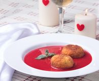 Strawberry soup with italian fried rice balls Royalty Free Stock Image