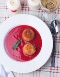 Strawberry soup with italian fried rice balls arancini. Stock Image