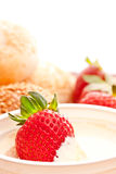 Strawberry in Sour Cream. Fresh strawberry in sour cream, close up Stock Images