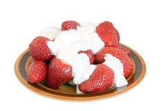 Strawberry with sour cream. Fresh strawberry with sour cream on ceramic plate over white background Stock Photos