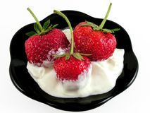 Strawberry in sour cream. royalty free stock images
