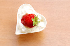 Strawberry in sour cream Royalty Free Stock Photo