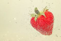 Strawberry in sparkling water closeup Royalty Free Stock Photography
