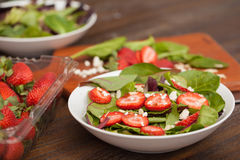 Strawberry and spinach salad in a bowl Stock Images