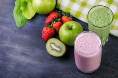 Strawberry and spinash smoothies in glasses with ingredients Royalty Free Stock Photography