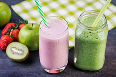 Strawberry and spinash smoothies in glasses with ingredients Stock Photography