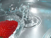 Strawberry splash. A strawberry dropping in a water tank, with space for copy. Sharp shot royalty free stock photography