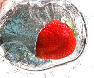 Strawberry splash 4. Strawberry dropped in water royalty free stock photo