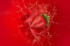 Strawberry splash into juice Royalty Free Stock Photo