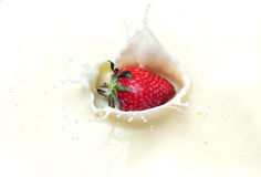 Strawberry splash in milk Stock Photo