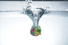 Strawberry splash. Play with water and fruits Royalty Free Stock Photos