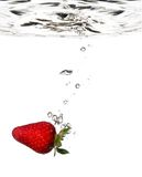 Strawberry splash in water stock photos
