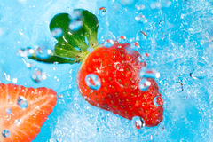 Strawberry splash in water- top view Royalty Free Stock Images