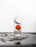 Strawberry Splash White Background Black Surface Stock Photos