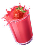 Strawberry splashing in a creamy red liquid. Stock Photos