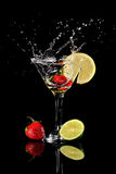 Strawberry Splashing Into Drink Stock Images