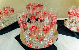 Strawberry splashing into a glass of champagne Royalty Free Stock Photography