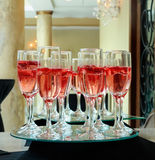 Strawberry splashing into a glass of champagne Stock Photos
