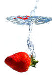 Strawberry splashing water Royalty Free Stock Images