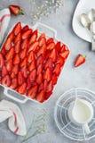 Strawberry sponge cake on white baking dish Royalty Free Stock Image