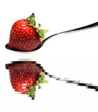 Strawberry on Spoon. Over water with reflection Royalty Free Stock Image