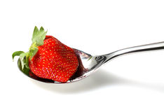 Strawberry on spoon Stock Images