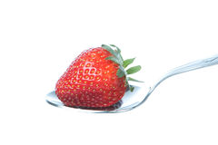 Strawberry on a spoon. Royalty Free Stock Images