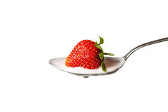Strawberry in the spoon full of yoghurt Royalty Free Stock Images