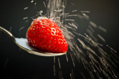Strawberry on a spoon Stock Image
