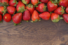 Strawberry spread on brown wooden surface Royalty Free Stock Photo