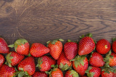 Strawberry spread on brown wooden surface Stock Images