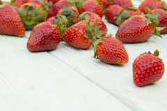 Strawberry spread on a wooden surface Stock Images