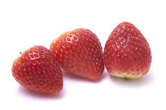 Strawberry without stalk. Close up shot of strawberry isolated on white background without stalk Stock Image