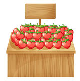 A strawberry stand with an empty wooden signboard Stock Photo