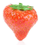 Strawberry standing on white surface Stock Photography
