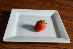 Strawberry. A straw berry on a white plate taken at125yh at f11 Stock Photography