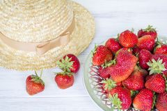 Strawberry and straw hat. Summer still life. Royalty Free Stock Images