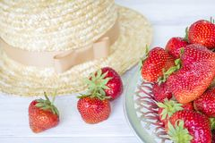 Strawberry and straw hat. Summer still life. Royalty Free Stock Photos