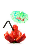 Strawberry with straw and umbrella Stock Image