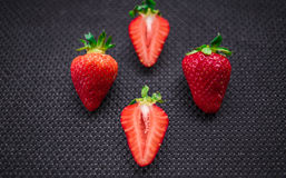 Strawberry. N solid background. Black. Facture stock image