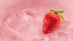 Strawberry submerged in liquid with consistency of milk Royalty Free Stock Photography