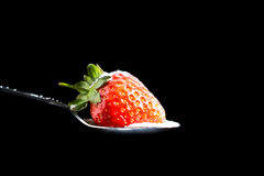 Strawberry and Sugar. Picture of a Strawberry being sprinkled with Sugar stock photo