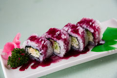 Strawberry Sushi. In the white plate stock images