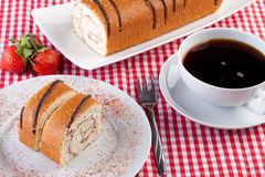 Strawberry swiss roll with a cup of coffee Royalty Free Stock Photos